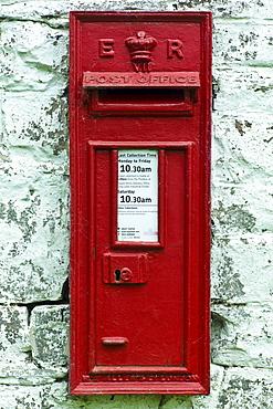 Wall mounted postbox with E R Elizabeth Regina cypher in Anchor, Shropshire, United Kingdom