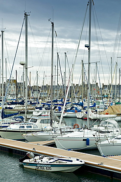 Yachts and power boats moored in the Marina at St Vaast la Hougue channel port in Normandy, France