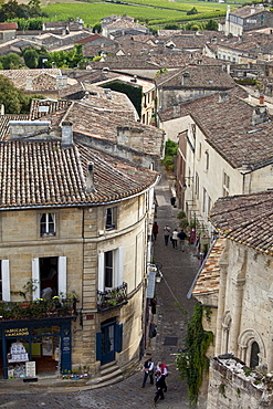 View of tourists strolling in St Emilion from L'Eglise Monolith, Monolithic church, in the Bordeaux region of France