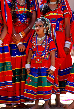 Young pretty girls in brightly coloured national costume and jewels at a festival in Calcutta, India