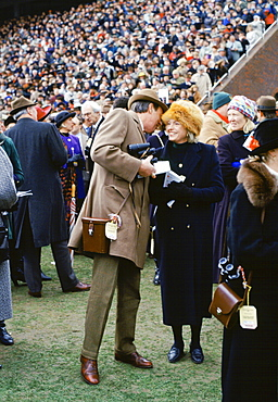 Spectactors in front of grandstand at Cheltenham Racecourse for the National Hunt Festival of Racing, UK