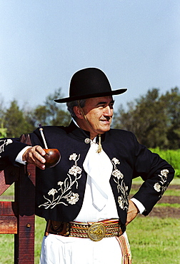 Gaucho in traditional costume drinking local speciality mate tea at Las Brujas Ranch, Uruguay