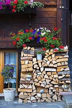 Woodpile at Swiss timber house in 18th century Brunngasse at Brienz in Bernese Oberland, Switzerland, Europe