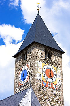 Clock tower of Klosters church in Graubunden region of Switzerland, Europe