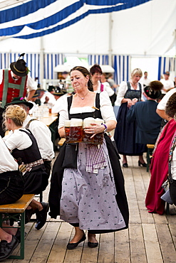 Woman in costume as serving wench at beer festival in the village of Klais in Bavaria, Germany, Europe
