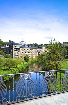 Benedictine monastery of Samos, Mosteiro San Julian de Samos, and Camino shell detail in bridge in Galicia, Spain, Europe