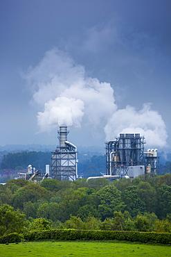 Steaming smoke stacks at Kronospan Factory making wood based panels, chipboard and MDF at Chirk in Wrexham, Wales, United Kingdom, Europe