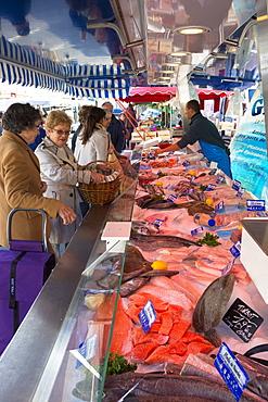 French women shopping for fresh wet fish in artisan food market at Morannes, Maine-et-Loire, France, Europe