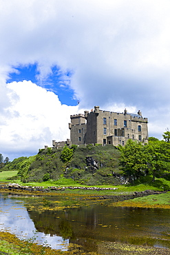 Ancient Highland fortress Dunvegan Castle, the ancestral home of the MacLeod clan, by Dunvegan Loch, a sea loch on the Isle of Skye, Inner Hebrides, Scotland, United Kingdom, Europe