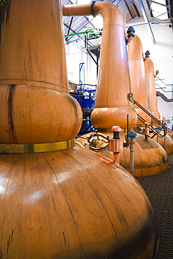 Copper stills for whisky process in traditional Still House part of Visitor Centre visitors tour at Tobermory Distillery, Isle of Mull, Inner Hebrides and Western Isles, Scotland, United Kingdom, Europe
