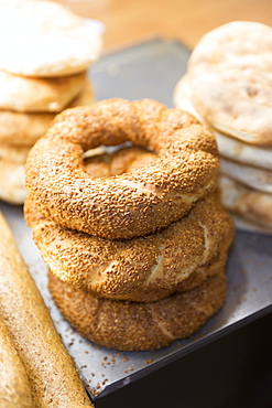Traditional bread simit Turkish sesame seed bread rings in food market in Kadikoy district on Asian side of Istanbul, Turkey, Asia Minor, Eurasia