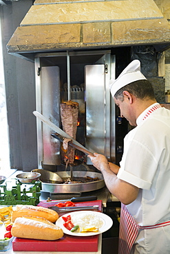 Chef at Ciya Sofrasi Turkish restaurant slicing lamb doner kebab in Kadikoy district, Asian side Istanbul, East Turkey, Asia Minor, Eurasia