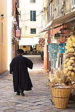 Greek Orthodox priest in traditional robes in street scene in Kerkyra, Corfu Town, Corfu, Greek Islands, Greece, Europe