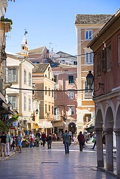 Tourists and local people in street scene in Kerkyra, Corfu Town, Corfu, Greek Islands, Greece, Europe