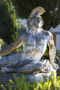Stone statue of reclining figure of Dying Achilles (Achilleas thniskon) at Achilleion Palace, Museo Achilleio, in Corfu, Greek Islands, Greee, Europe