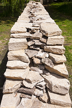 Newly built dry stone wall constructed of new Cotswolds stone using traditional old methods, Oxfordshire, England, United Kingdom, Europe