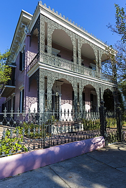 Traditional grand mansion house with ornate wrought iron in the Garden District of New Orleans, Louisiana, USA