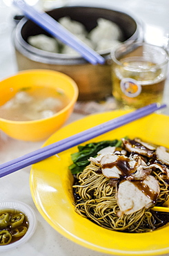 Pork noodles (mee), served with pickled chillies, a broth, wontons and beer, at Taman Dessa food court, Kuala Lumpur, Malaysia, Southeast Asia, Asia