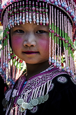 A girl in traditional hilltribe costume, Wat Phra That Doi Suthep, Chiang Mai, Thailand, Southeast Asia, Asia