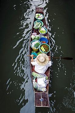 A vendor paddles their boat, Damnoen Saduak Floating Market, Thailand, Southeast Asia, Asia