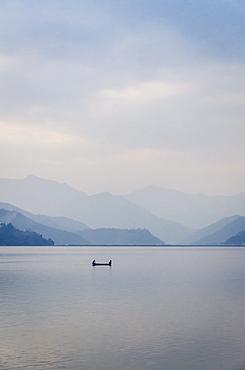 A rowboat on Phewa Tal (Phewa Lake), Pokhara, Nepal, Asia