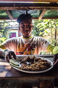 A waiter prepares to serve pakoras, Pokhara, Nepal, Asia