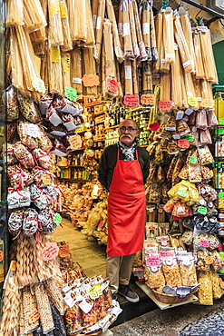 Grocery store owner proudly stands at shop front with pasta, City of Naples Historic Centre, UNESCO World Heritage Site, Naples, Campania, Italy, Europe