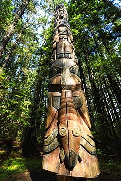 Lakich'inei Pole, Tlingit totem pole, lit by sun in rainforest, Sitka National Historic Park, Sitka, Baranof Island, Alaska, United States of America, North America