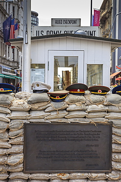 Commemorative plaque, guardhouse, sandbags and uniform caps, Checkpoint Charlie, Mitte, Berlin, Germany, Europe