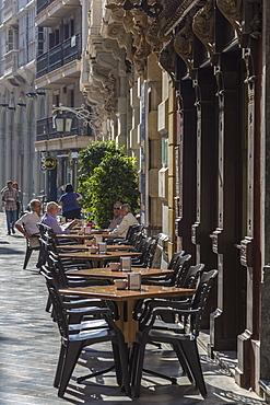 Men sit at cafe tables in the main street, Cartagena, Murcia Region, Spain, Europe