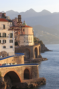 Church of Santa Maria Maddalena and coast road with mountains, warm early morning light, Atrani, near Amalfi, Costiera Amalfitana (Amalfi Coast), UNESCO World Heritage Site, Campania, Italy, Europe
