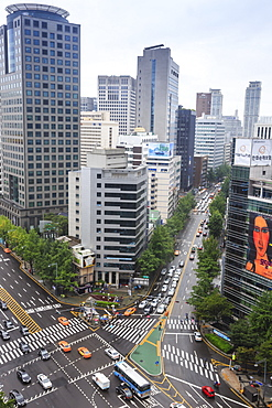Elevated view of a busy city centre street and high rise buildings on a rainy summer day, City Hall area, Seoul, South Korea, Asia