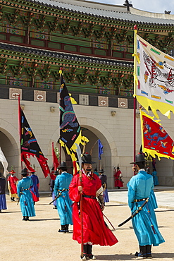 Marching with flags at Gwanghwamun gate, colourful Changing of the Guard Ceremony, Gyeongbokgung Palace, Seoul, South Korea, Asia