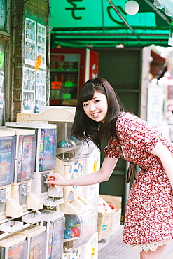 Japanese girl buying candies at an old candy shop