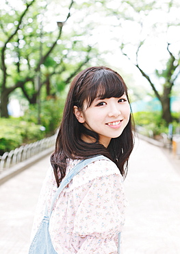 Portrait of a Japanese girl smiling while looking at camera