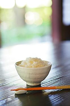 Bowl Of Rice And Chopsticks