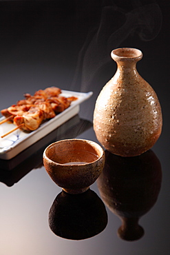 Traditional Japanese Sake Cup and Jug