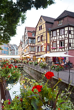 People enjoying a beautiful day in a café at the 'Place de l Ancienne Douane', Colmar old town, Alsace