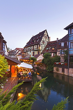 Petite Venise (Little Venice), Colmar, Alsace; a view from the Rue Turenne canal bridge onto La Lauch with restaurants lining the canal side