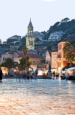 People at Hvar old town at twilight in Croatia