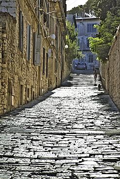Old town cobblestones alley in Pula, Croatia