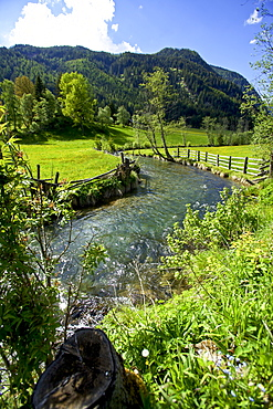 View of river and meadow in Lungau, Austria