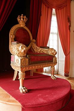 Red chair in Throne room at Weissensteinflugel Museum, Kassel, Hesse, Germany
