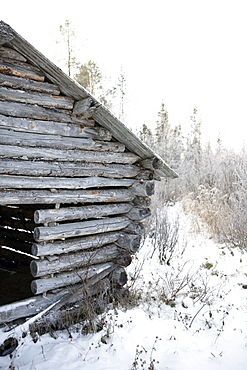 View of wooden hut on landscape, Lapland, Finland