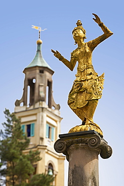 Statue of Burmese dancer in Portmeirion village, Gwynedd, Wales, UK