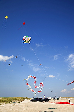Multi-coloured flags in sky on kite festival at Fano beach, Denmark