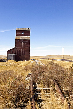 Railway tracks and wooden house at Saskatchewan, Canada