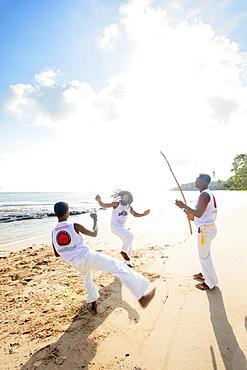 Local people playing capoeira on the beach, Boipeba Island, Tinhare, Brazil, South America