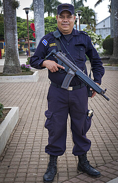 An armed policeman in El Salvador, Central America
