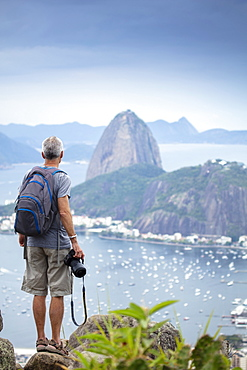 A photographer shooting the the famous Sugar Loaf mountain in Rio de Janeiro, Brazil, South America